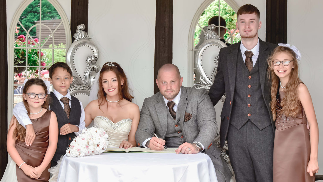 Bride groom and family at the signing of the registerPicture