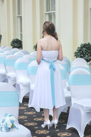 Picture Bridesmaid standing in the ceremony area of a luxury wedding venue hotel