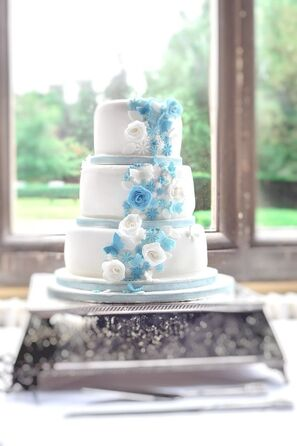 Tier wedding cake with blue rose petal icing decorations