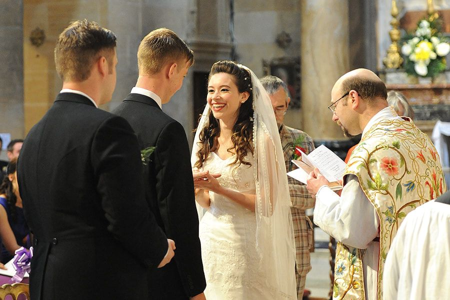 Picture image of Rosie and Stuart exchanging rings in their wedding ceremony