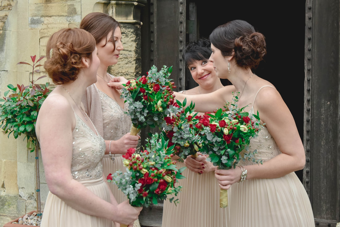 reportage image of bridesmaids waiting outside church